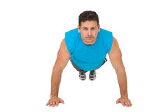 Portrait of a determined man doing push ups Royalty Free Stock Photo