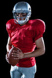 Portrait of determined sportsman with American football Stock Photo
