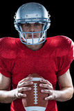 Portrait of determined sportsman with American football Stock Image
