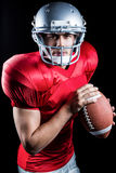 Portrait of determined sportsman holding American football Stock Images