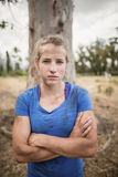 Portrait of determined woman standing with arms crossed during obstacle course Royalty Free Stock Photo