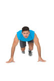 Portrait of a determined young man doing push ups Royalty Free Stock Photo