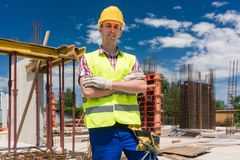 Portrait of a determined young worker looking at camera with con royalty free stock photography