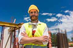 Portrait of a determined young worker looking at camera with con stock photo