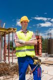 Portrait of a determined young worker looking at camera with con Royalty Free Stock Photo