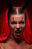 Portrait of a devil with horns. Fantasy. Art Royalty Free Stock Image