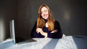 Portrait of dimples young girl with laptop, beautiful woman sitt Royalty Free Stock Photos