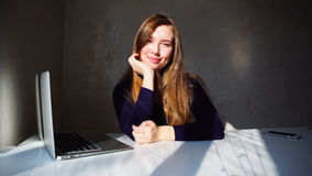 Portrait of dimples young girl with laptop, beautiful woman sitt Stock Image