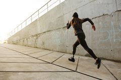 Portrait of disabled athlete woman with prosthetic leg in tracks royalty free stock photo