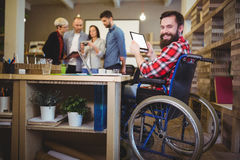 Portrait of disabled businessman using digital tablet Royalty Free Stock Photography