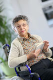 Portrait of disabled elderly lady with a book Stock Photo