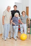 Portrait Of Disabled Senior People With Trainer Stock Photos