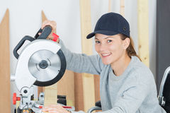 Portrait disabled woman using circular saw Royalty Free Stock Images
