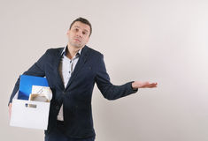 Portrait of disappointed businessman with office stuff in the bo Stock Image