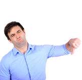 Portrait of disappointed young businessman showing thumb down Royalty Free Stock Photos