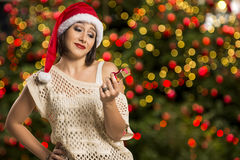 Portrait of disappointed young woman holding Christmas gift. Stock Image