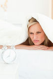 Portrait of a disgruntled woman waking up Royalty Free Stock Photos