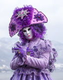 Portrait of a Disguised Person. Annecy, France- February 23, 2013:Environmental portrait of an unidentified person disguised in a beautiful violet costume in Royalty Free Stock Photos