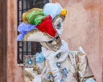Portrait of a Disguised Person. Venice, Italy- February 18, 2012: Environmental portrait of a person disgused in a beautiful old-fashioned style costume posing Stock Image