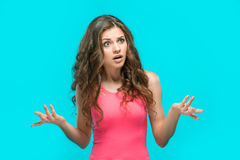The portrait of disgusted and perturbed woman. On blue background Stock Images