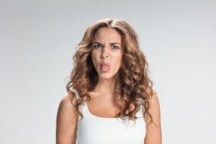 Portrait of disgusted woman. The portrait of disgusted woman on gray Stock Image