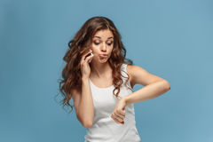 The portrait of disgusted woman with mobile phone Stock Image