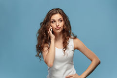 The portrait of disgusted woman with mobile phone Royalty Free Stock Photography