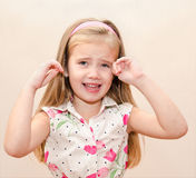 Portrait of disobedient  little girl Royalty Free Stock Photo