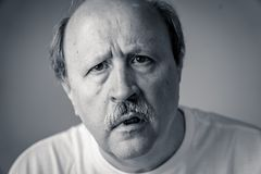Portrait of disorientated and confused old man suffering from Alzheimer royalty free stock images