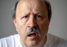 Portrait of disorientated and confused old man suffering from Alzheimer royalty free stock image