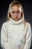 Portrait of a displeased little girl in eyeglasses Royalty Free Stock Photos