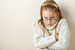 Portrait of a displeased little girl in eyeglasses Stock Images