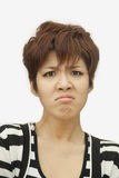 Portrait of displeased short haired young woman, studio shot Royalty Free Stock Photos