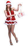 Portrait of displeasured girl and some gifts. Portrait of beautiful displeasured woman weared in santa clause dress and some gifts Royalty Free Stock Photos
