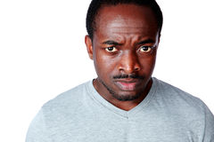 Portrait of a dissatisfied african man. Over white background stock photography