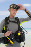 Portrait of a diver. Portrait of an handsome caucasian diver posing at the beach Stock Photography