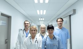 Medical teams standing with arms crossed in the corridor at hospital royalty free stock image