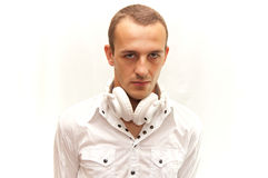 Portrait of dj. Dj with white headphones looking at camera, isolated on white Stock Photo