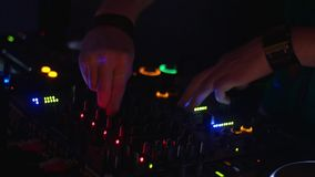 Portrait of Dj spinning at turntable on party in nightclub. Equipment. Mixing. Cheering stock footage