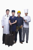 Portrait of Doctor, Air Stewardess, Construction Worker, and Chef- Studio Shot Stock Photo
