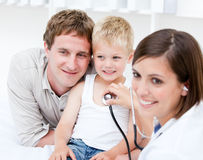 Portrait of a doctor examining a boy Royalty Free Stock Photo