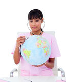 Portrait of a doctor examining a terrestrial globe Royalty Free Stock Photo