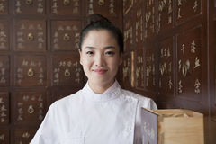 Portrait of Doctor In Front of Traditional Chinese Medicine Cabinet stock image