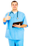 Portrait of a doctor gesturing thumds up sign Royalty Free Stock Image