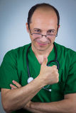Portrait of doctor in green uniform showing ok sign Royalty Free Stock Image