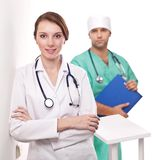 Portrait of doctor with her colleague. Stock Photos