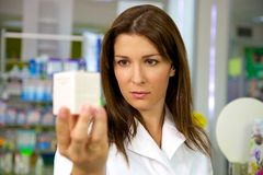 Portrait of doctor holding medicine in pharmacy Royalty Free Stock Photos