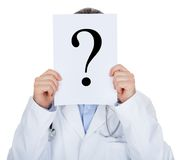 Portrait of doctor holding paper with question mark Royalty Free Stock Photography