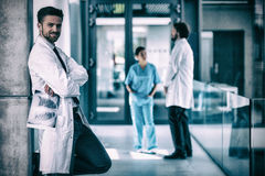 Portrait of doctor holding x-ray while standing against wall Stock Photography