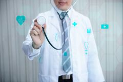 Portrait of doctor holding stethoscope for physical examination royalty free stock photo